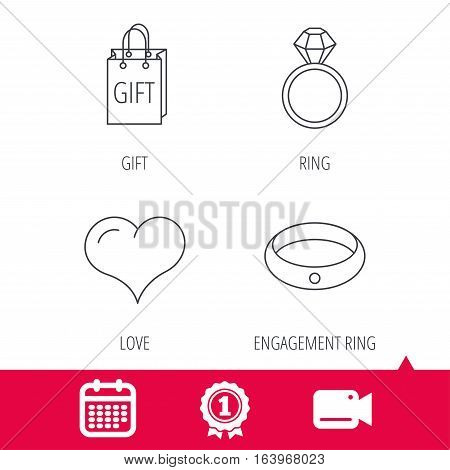Achievement and video cam signs. Love heart, gift bag and wedding ring icons. Engagement ring linear sign. Calendar icon. Vector