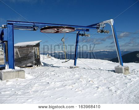 End hoop ski lift on the mountain in winter