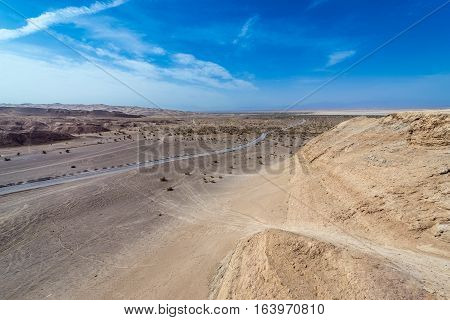 Aerial view with a road on Maranjab Desert in Iran
