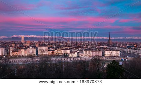 Torino (turin, Italy): Expansive Cityscape At Dusk With Scenic Colorful Light On The Snowcapped Alps