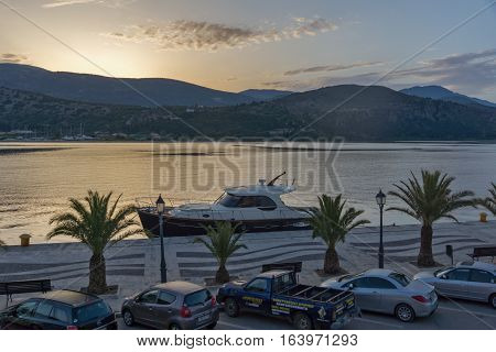 Argostoli, Kefalonia, Greece - May 26  2015:  Sunrise view of Embankment and port of Argostoli, Kefalonia, Ionian islands, Greece