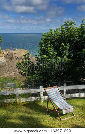 Chaise lounge on the green lawn. Excellent View of the Bay of Combe Martin. North Devon. UK
