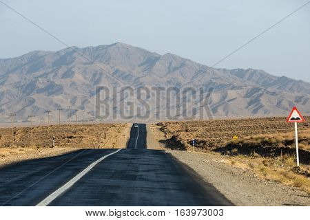 Straight asphalt road in Isfahan Province in Iran