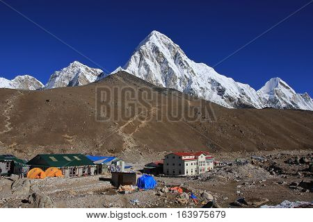 Last settlement before the Everest base camp. Popular view point Kala Patthar. Snow covered mount Pumori.