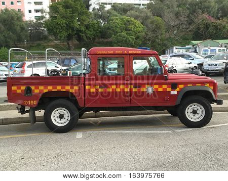 Gibraltar, Gibraltar - December 29, 2016: Red Gibraltar Fire Brigade Land Rover Defender parked on a public parking spot in the city of Gibraltar. Nobody in the vehicle.