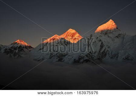 High mountains Khumbutse Everest and Nuptse at sunset.