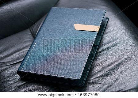 Dark blue colored organizer book in car