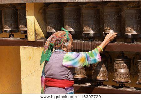 Prayer wheels in buddhist temple