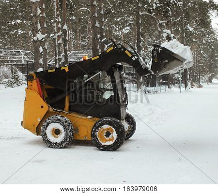 Snow loader clearing the road from snow, Novosibirsk, Siberia