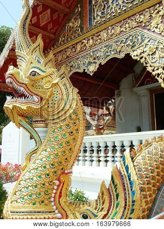 Dragon statue in front of a Buddhist temple in Chiang Mai, Thailand