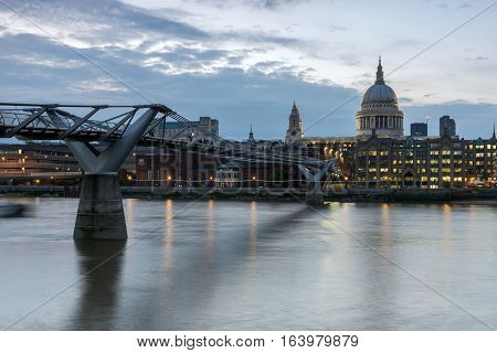 LONDON, ENGLAND - JUNE 17 2016: Twilight panorama of  Millennium Bridge and  St. Paul Cathedral, London, Great Britain