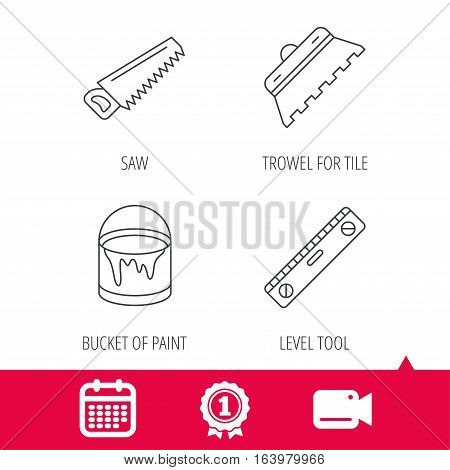 Achievement and video cam signs. Trowel for tile, saw and level measure icons. Bucket of paint linear sign. Calendar icon. Vector