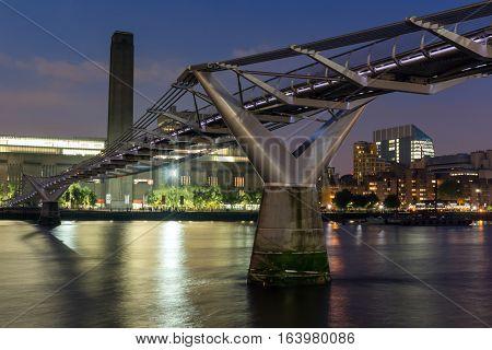 LONDON, ENGLAND - JUNE 17 2016: Night Panorama of Millennium Bridge, Tate Modern Gallery and Thames River, London, United Kingdom