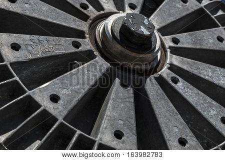 Abstract photograph of pulley wheel used in ski chairlifts with a weathered patina after being abandonded.