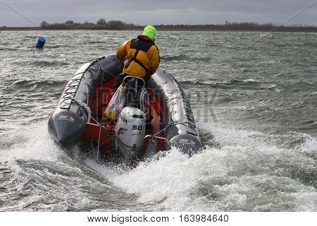 A rigid inflatable boat RIB powering through waves