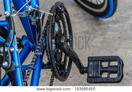 a bicycle gears mechanism and chain on the front wheel