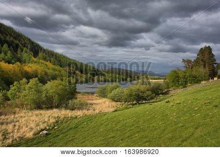 A Lake In Snowdonia Under A Grey Cloudy Sky