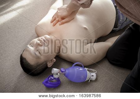 Basic Life Support of Demonstrating chest compressions on CPR obese patients