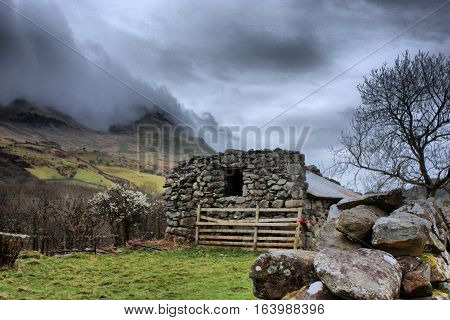 Stone Building In Front Of Cadair Idris Mountain Range In Snowdonia