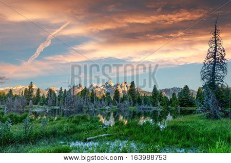 Vibrant sunrise over the Grand Teton Mountain Range