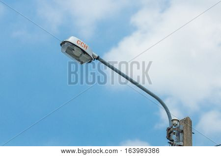 street lamp post and Electric wire in dark or evening light and blue sky.