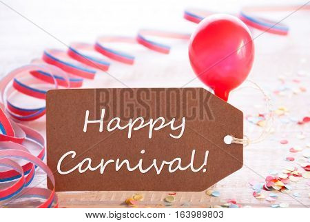 One Label With English Text Happy Carnival. Party Decoration Like Streamer, Confetti And Balloon. Wooden Background With Vintage, Retro Or Rustic Syle