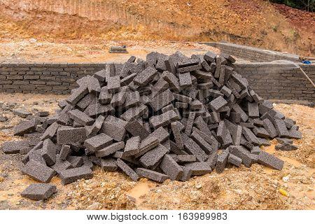Black Clay Bricks For Building At Construction Site