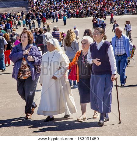 FATIMA, PORTUGAL - MAY 11, 2014 Nuns Believers Pilgrims Worshipers May 13th Celebration Basilica of Lady of Rosary Bell Tower Fatima Portugal.