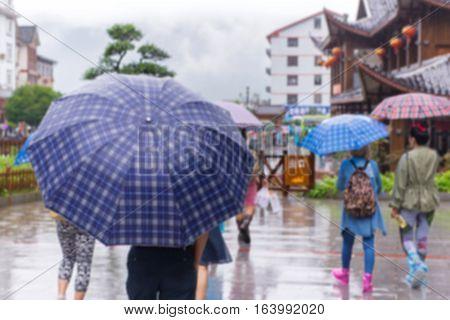 People With Umbrella Walking In The Falling Rain