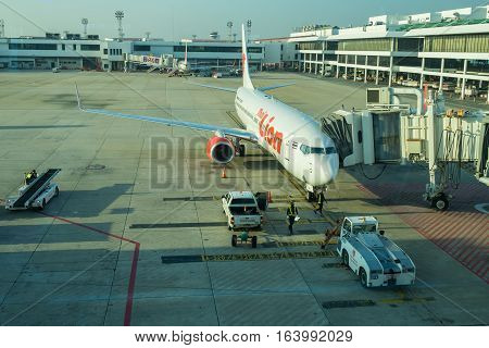 BANGKOK, THAILAND-DEC 29 2016. Thai Lion airline loading cargo on the plane at the gate in Don Mueang international airport (DMK)