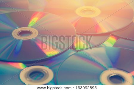 colorful compact discs set of cds scattered on a table.