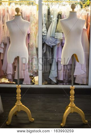 Two White female dressmakers dummies tailor mannequins