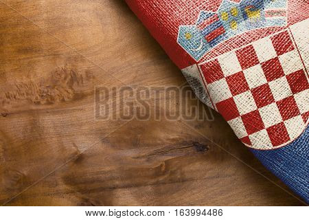 Flag of Croatia state on a wooden background.