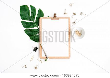 Mockup with clipboard palm leaf and clips. Flat lay top view