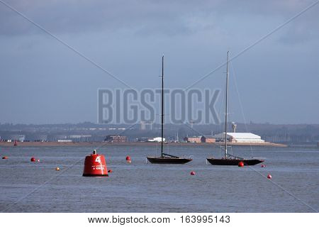 boats tied to moorings at cowes on the solent