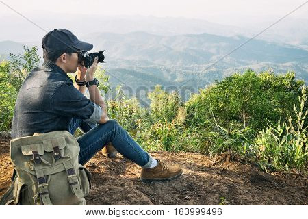 Young Professional Travrler Man With Camera Shooting Outdoor, Fantastic Mountain Landscape