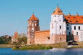 Mir, Belarus. Scenic View Of Mir Castle Complex From Side Of Lake. Architectural Ensemble Of Feudalism, Ancient Cultural Monument, Unesco Heritage. Famous Landmark In Summer Sunny Day Under Blue Sky poster