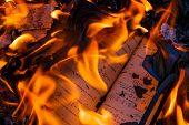 Burning a book, a textbook on higher mathematics poster