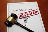 Affordable Care Act aka ObamaCare policy with Repealed stamp and gavel poster