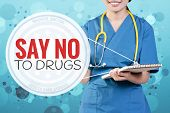 Smile female doctor with blurry blue glitter point to text: Say No To Drugs poster