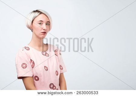 Young Beautiful Sad Woman Serious And Concerned Looking With Worried And Thoughtful Facial Expressio