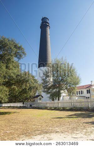 Pensacola Lighthousein Front Of Blue Sky In Pensacola Florida