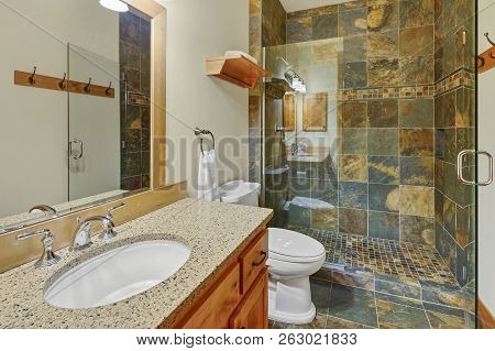 Luxury Bathroom Interior With Natural Stone Tile.
