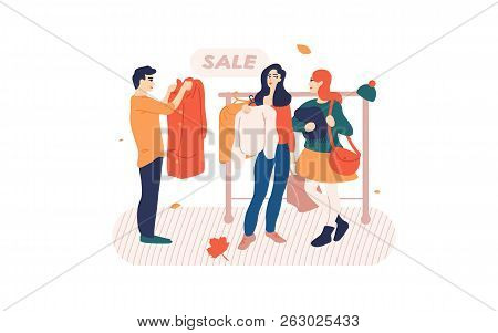 People Browsing Clothes On A Rack In Store.