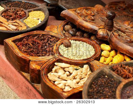 Different spices in handmade wooden box