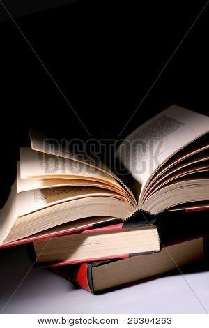 pile of books, dim lighting for effect