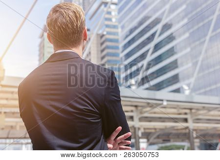 Back View Of Caucasian Businessman Looking At Office Building Background For Business Vision Concept