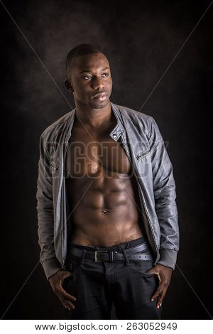Shirtless Muscular Black Young Man In Studio Shot