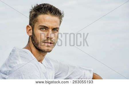 Handsome Young Man At Seaside In Summer Day