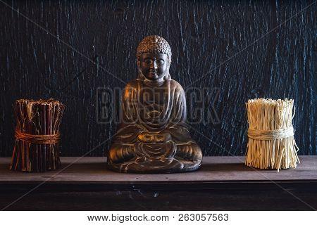 Decorative Bronze Budha Trinket On Wall Shelf Of A Cafe Shop